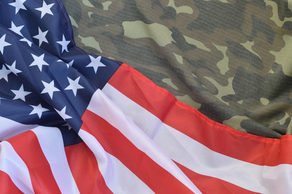 United States of America flag and folded military uniform jacket